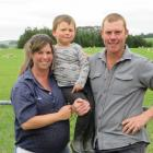 Moa Flat sheep and beef farmers Liz and Sam Barton (pictured with son Angus)