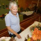Jane Pheasant, of Dunedin, admires the floral arrangements. Photos: Alexia Johnston