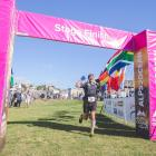 Keith Burrows, of England, celebrates as he crosses the line in the 2019 Anchor Milk Otago Alps 2...