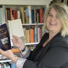 Dunedin teacher and researcher Deirdre Cooper holds a 19th-century diary and her recent book,...