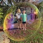 Anna (10) and William (7) Hepburn in their backyard bubble at home in Maori Hill. PHOTO: AL HEPBURN