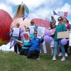 Queenstown and Cromwell nurses join forces at the Big Fruit sculpture yesterday to protest...