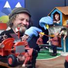 Pixie mechanic Stephen Kilroy makes some adjustments to a display at Pixie Town, which opens in...