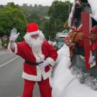 Santa Claus and his elves prepare for the start of the parade.