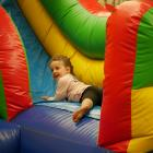 Stella Brown (4), of Brighton, plays on an inflatable slide.