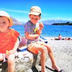 Casey (4, left) and Riley Moore (6) enjoy a picnic lunch at Lake Wanaka.PHOTO: JOHN WEKKING