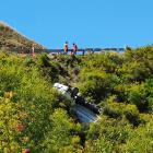 A truck came to a crashing halt on the cliff edge of the Crown Range Rd between Queenstown and...