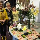 Admiring the top award winners at the Otago Lily Society show on Saturday are (from left) Jo...