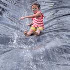 Annabelle  Cope (7), of Dunedin, slips  down a waterslide.  PHOTOS: SHAWN MCAVINUE