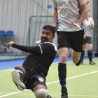 Amish Chard, of Hauraki Plains School, shoots for goal while Mark Jones, of Rototuna High School,...