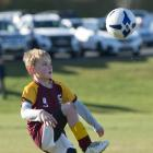 Maori Hill Red player Ollie Agnew (9) warms up before a game at the annual Green Island Junior...