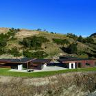 Nestled against a tussock-covered hill, this steel-clad Queenstown home sits perfectly within its...