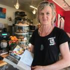 The Wobbly Goat owner Sarah Moore shows a cookbook which features some of the cafe's recipes....
