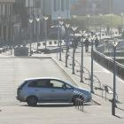 Pedestrians and cyclists enjoy the calm at St Clair Esplanade yesterday while maintaining...