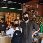 ADJO cafe owners Caitlin Holloway and Jonas Jessen Hansen, with Ashley Heydon making coffee, are...
