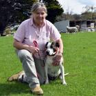 Teacher Elizabeth Prentice hugs her dog Meg — who she rescued from Retired Working Dogs — in...