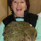 Conservation Minister Maggie Barry holds a kakapo chick at the Department of Conservation chick...