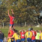 Kurow No 8 Sam Forsyth rises high in a lineout during a North Otago club rugby game against...