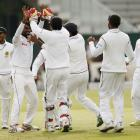 Sri Lanka's Nuwan Pradeep (2nd L) celebrates with team mates after bowling out England's James...