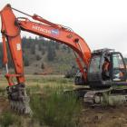 Colin Ashmore of BWC Ltd, Cromwell,  helps with  the first earthworks on the new Cromwell...