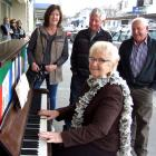 Alexandra musician Valerie Anderson plays for shoppers, watched by (from left) Yvonne Tohill, of...