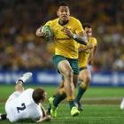 Israel Folau with the ball for Australia against England. Photo: Getty Images
