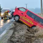 Outram volunteer firefighters clear the Henley - Berwick Rd after a courier van left the road...