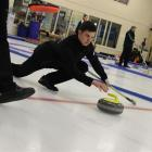 Matthew Neilson, of Ranfurly, slides a stone with pinpoint precision at the New Zealand Curling...