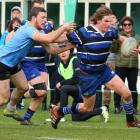 Action from the Kaikorai v University A game. Photos Caswell Images