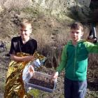 After their rescue, Harvey Brown (left) and Carter Pearson display the 'treasures' they gathered...