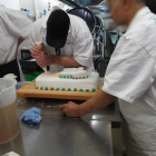 An Otago Corrections Facility prisoner adds the finishing touches to a celebratory cake marking...