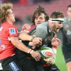 Kieran Read of the Crusaders tackled by Andries Coetzee of the Lions during the Super Rugby match...