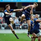 Kaikorai wing Danny Van der Voort is safe under the high ball as he is challenged by Dunedin's...