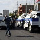 Police block a street after the police station was seized. Photo: Reuters