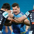 Greg Bird takes the ball into contact for the Titans against the Sharks. Photo: Getty Images