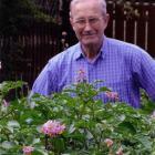 Dave Young stands behind his potato crop in his Mosgiel garden in December.