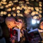 People attend the 'Weihnachtssingen' a candle-lit carol concert. Photo by Reuters.