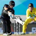 New Zealand's Corey Anderson hits out while being watched by Australia's Brad Haddin during their...