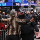 Police search a woman as she enters a pen in Times Square. Photo: Reuters