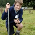 Taieri College pupil Alex Keith (14) takes soil samples as part of the science section of the...