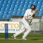 Scott potential . . . Otago batsman Bradley Scott watches an edge sail to safety on the third day...