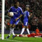 Liverpool's John Arne Riise, lies on the ground after scoring an own goal as Chelsea's Didier...