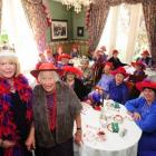 Dunedin Red reveller Queen Karen Lester (left) celebrate the brithday of Ros McKenzie (84) as...