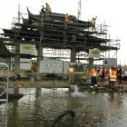 Construction work continues at the Dunedin Chinese Garden (at rear) while efforts are made to...