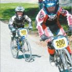 Josh Burnett (7) holds a slender lead over Braden Shields (7) halfway round the BMX course on...