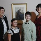 Hanlon family descendants with the Frances Hodgkins painting Old Woman Caudebec at its unveiling...