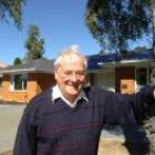Father Vince Walker in front of his new home in Holy Cross village. Photo by Peter McIntosh.