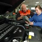 Queens High School pupil Hannah Gray receives training on a piece of diagnostic equipment from...