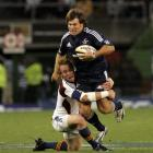 Stormers replacement Schalk Brits is tackled by Highlanders halfback Jimmy Cowan during their...