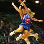 Liana Barrett-Chase, of the Steel, competes with Laura Langman, of the Magic, for the ball during...